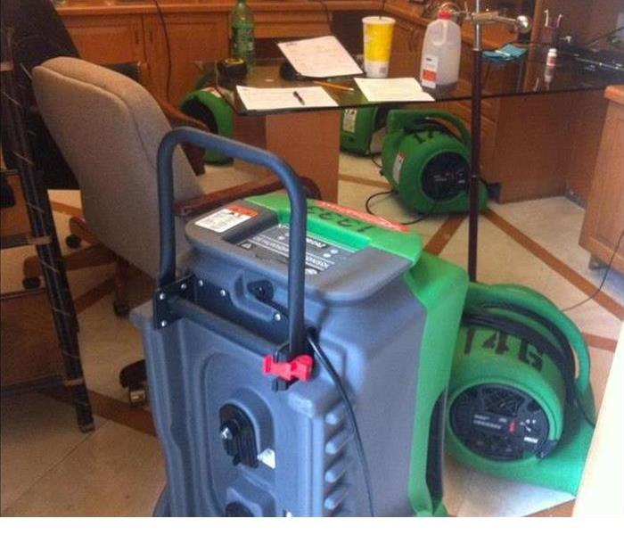 water damaged office with SERVPRO dehumidifiers set up
